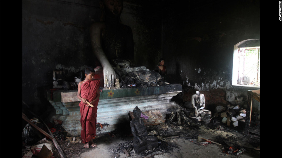A Buddhist monk looks over a burnted-out temple Tuesday in Cox's Bazaar, Bangladesh. Police said they had arrested nearly 300 people after Muslim mobs attacked temples and houses.