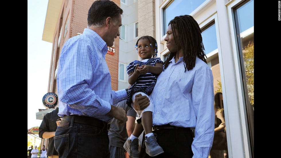 Romney greets a father and his daughter after having lunch Tuesday at a restaurant in Denver.