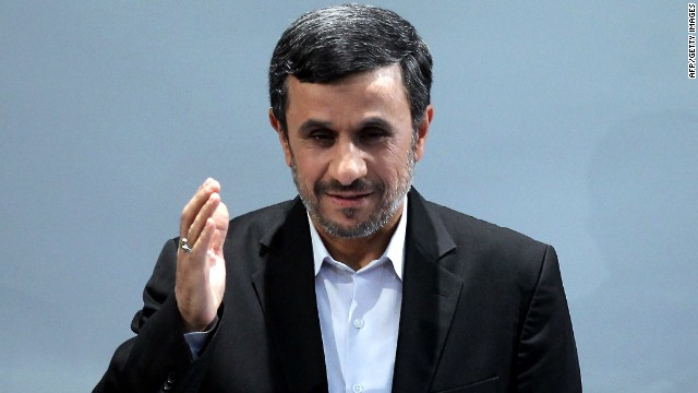 Iranian President Mahmoud Ahmadinejad waves during a press conference in Tehran on October 2, 2012. Iran will not back down on its nuclear programme despite economic problems caused by Western sanctions, Ahmadinejad said. AFP PHOTO/ATTA KENARE (Photo credit should read ATTA KENARE/AFP/GettyImages)