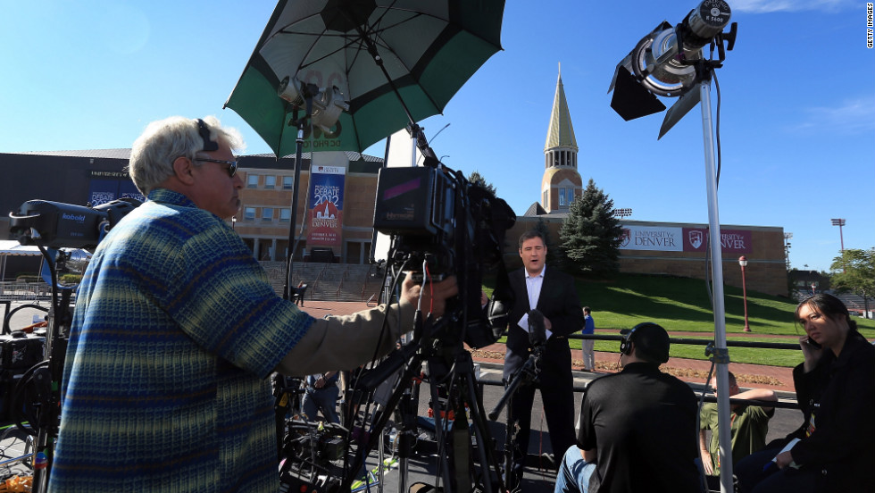Television crews begin to broadcast on Tuesday outside the Ritchie Center, where the first 2012 presidential debate will take place.