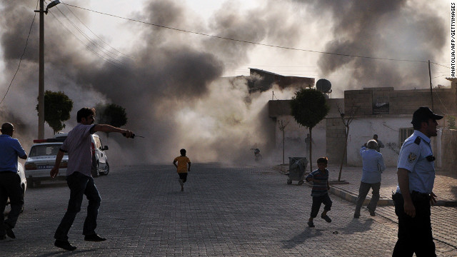 Smoke rises from an explosion after Syrian shells hit the town of Akcakale in Turkey, killing at least five people.