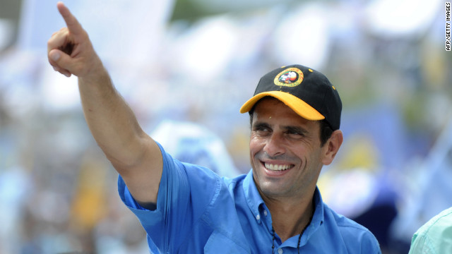 Venezuelan opposition leader Henrique Capriles Radonski gestures during a campaign rally on October 1.