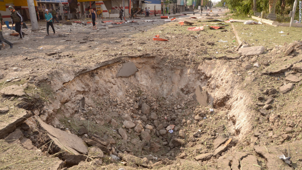 Car bomb explosions in Aleppo on Wednesday left a crater in the ground.