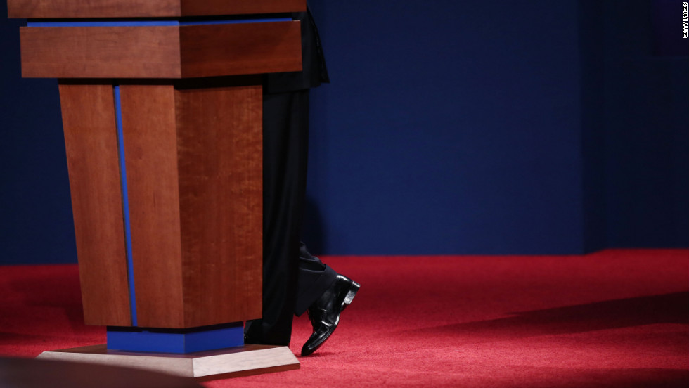 Obama stands at the podium as he speaks during the debate on Wednesday.