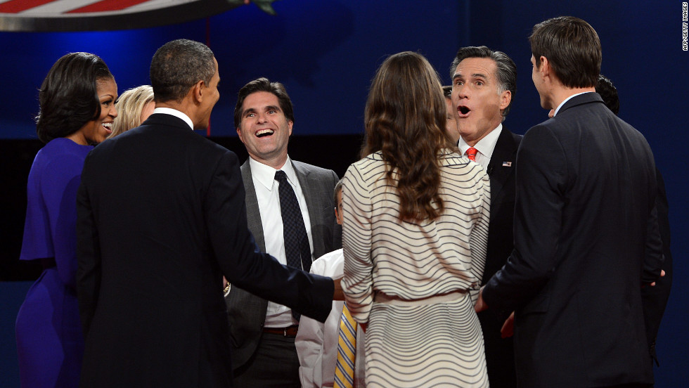 Michelle and Barack Obama, left, join Mitt Romney and his family at the conclusion of the first presidential debate.