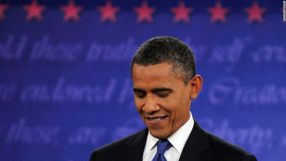 Obama listens during the debate in Denver.