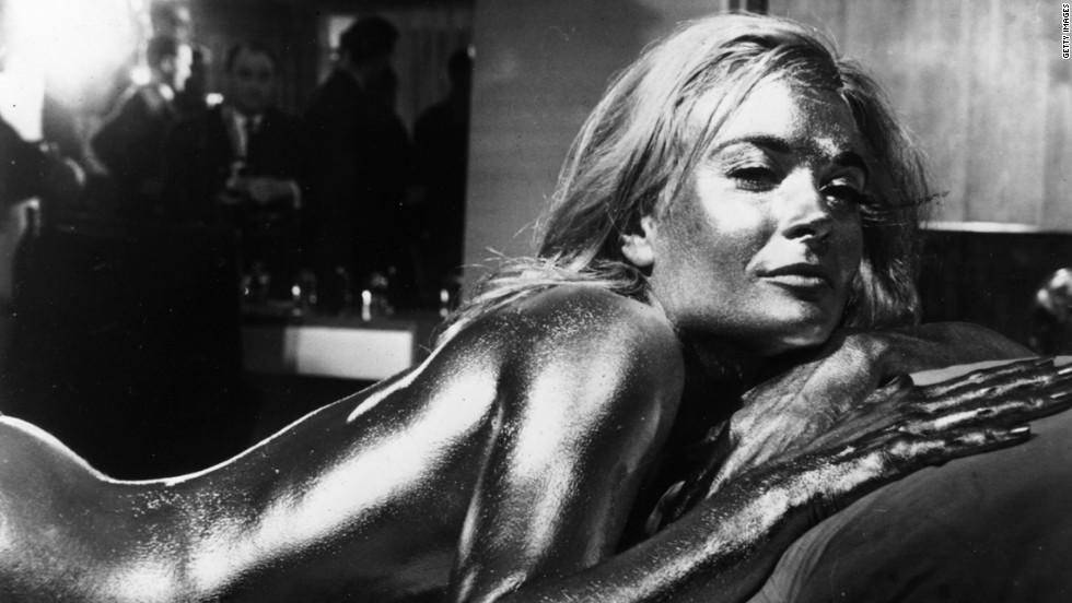 "English actress Shirley Eaton covered in gold in the James Bond film ""Goldfinger,"" directed by Guy Hamilton and starring Sean Connery."