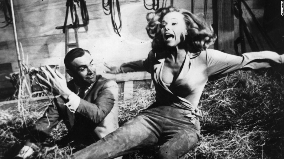 "Sean Connery's Bond is  up to his tricks with actress Honor Blackman as Pussy Galore during the filming of  ""Goldfinger"" in 1964."