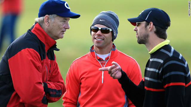 Actor Bill Murray (L) and Olympic swimming legend Michael Phelps (R) chat with English golfer Paul Casey