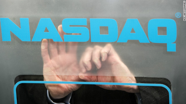 The hands of US Nasdaq Stock Market CEO Bob Greifeld are seen behind the logo as he opens its market remotely from the the World Economic Forum annual meeting on January 27, 2011 in Davos.