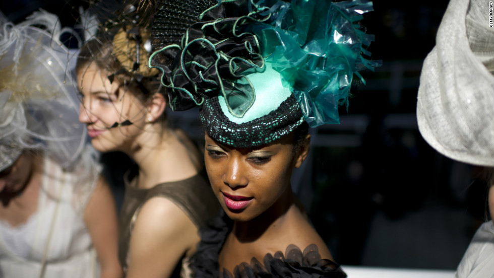 The fashion stakes are high at the Prix de 'Arc de Triomphe, with many race-goers opting for a classic, elegant style.