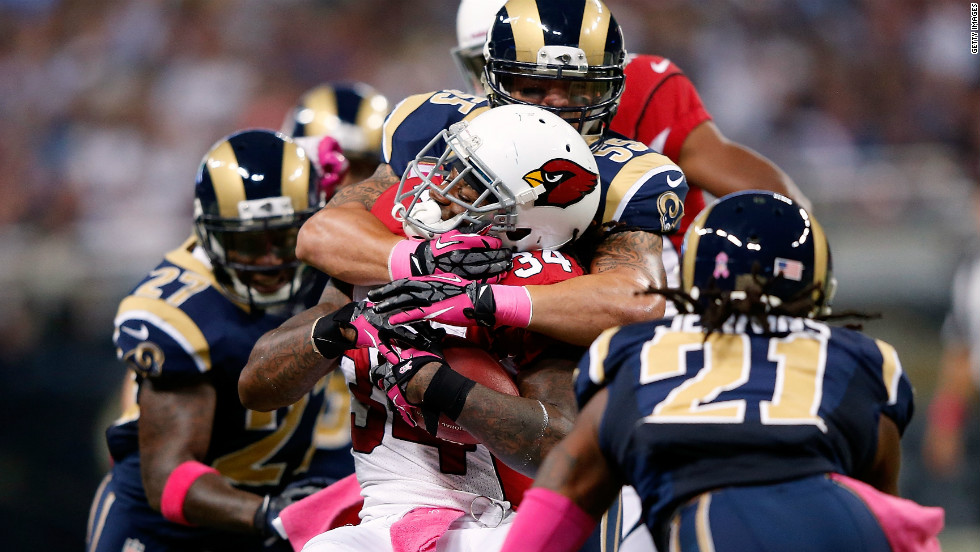 Ryan Williams of the Arizona Cardinals carries the ball with No. 55  James Laurinaitis of the St. Louis Rams on his back.
