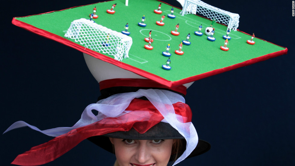 Some fashion racing accessories appear universal -- such as the obligatory outrageous hat. A Royal Ascot punter dons a football-themed hat at this year's races.
