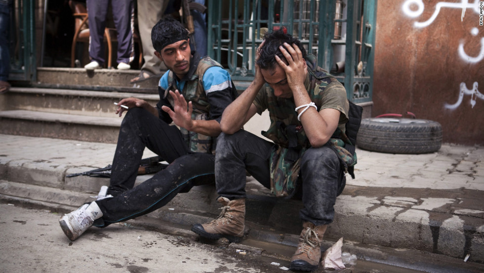 A Free Syrian Army fighter cries after one of his friends was injured in fighting with government forces outside the Dar El Shifa hospital on Thursday.