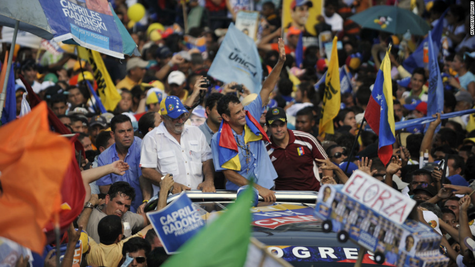Venezuelan opposition presidential candidate Henrique Capriles Radonski, center, waves to supporters during a campaign rally on Thursday in San Fernando de Apure.