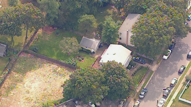 The remains of an unidentified infant were discovered in the backyard of this Long Island home.