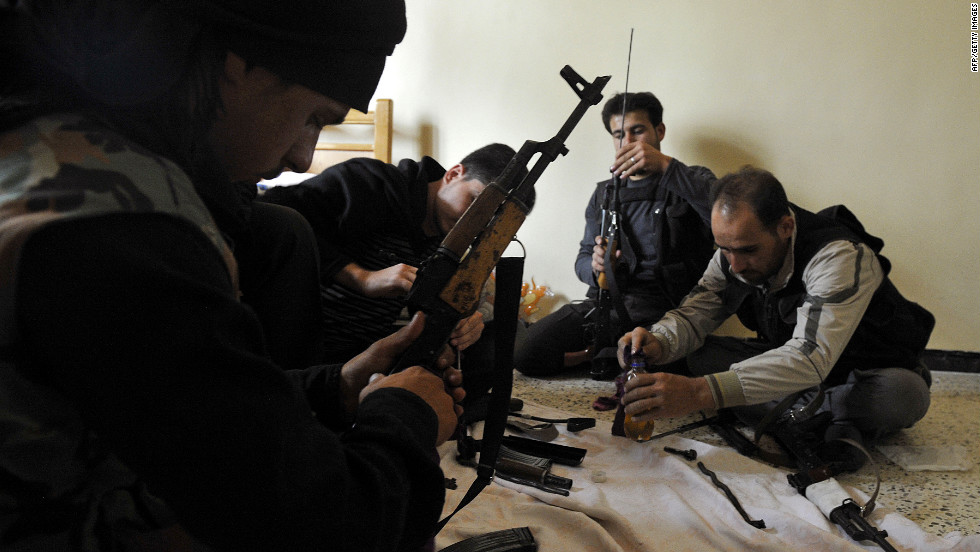 Syrian members of the Al-Saiqa rebel brigade clean weapons on Saturday before going to the front line in Aleppo.