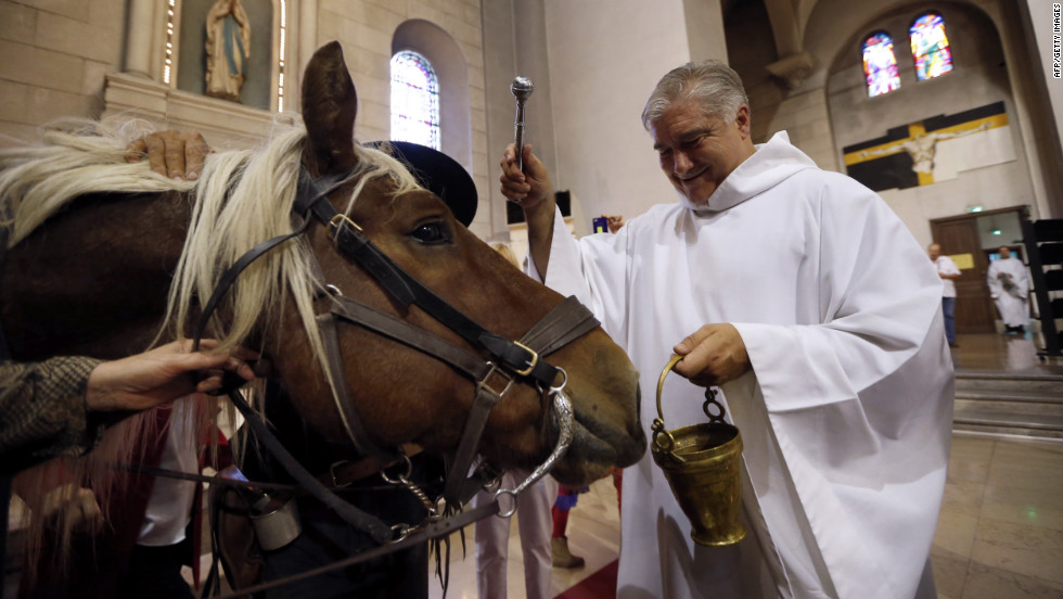 "Gil Florini, priest of St.-Pierre-d'Arene Church, blesses a horse during a Mass dedicated to animals to honor the feast of St. Francis of Assisi on Sunday, October 7, in Nice, France. Catholic churches around the world hold annual blessings of pets on the feast day of Francis, the patron saint of animals. <a href=""http://www.cnn.com/SPECIALS/world/photography/index.html"" target=""_blank"">Check out more of CNN's best photography.</a>"