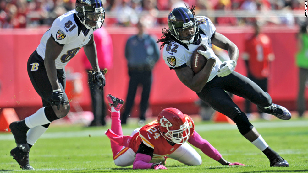 Torrey Smith of the Baltimore Ravens turns up field past Brandon Flowers of the Kansas City Chiefs in the first quarter Sunday.