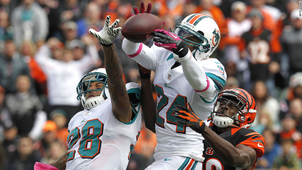 Sean Smith of the Dolphins bobbles a pass intended for A.J. Green of the Bengals.