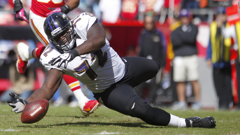 Kelechi Osemele of the Baltimore Ravens attempts to recover a fumble before the Kansas City Chiefs late in the fourth quarter Sunday at Arrowhead Stadium in Kansas City, Missouri.