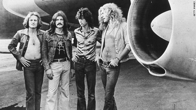 British rock band Led Zeppelin, (left - right): John Paul Jones, John Bonham (1948 - 1980), Jimmy Page and Robert Plant, pose in front of an their private airliner The Starship, 1973. (Photo by Hulton Archive/Getty Images)