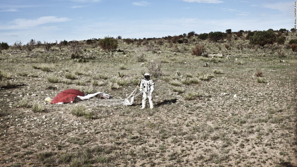 Baumgartner stands in the desert after completing the second manned test flight for Red Bull Stratos in Roswell, New Mexico, on July 25.