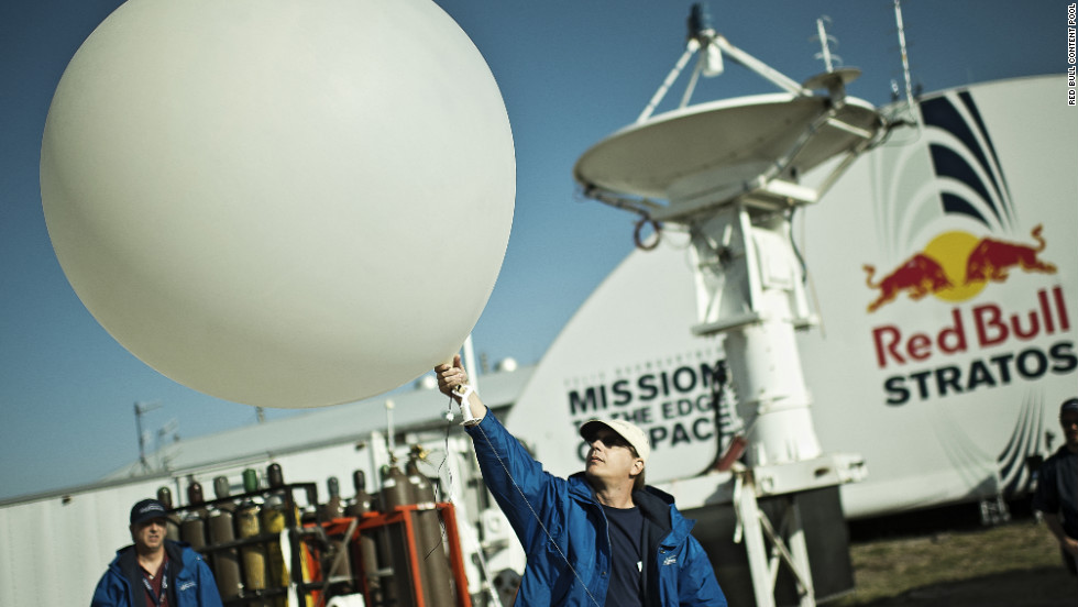 A crew member launches a weather balloon into the stratosphere on Thursday, October 4.