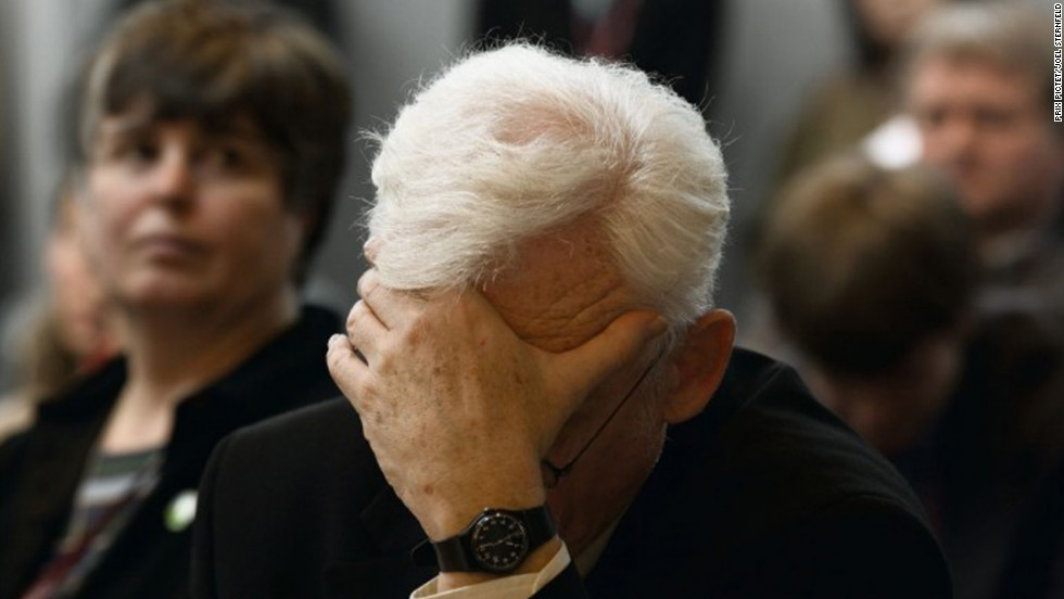 "A priest holds his head at the Commission on Ecology and Religion in Japan as part of Joel Sternfeld's series ""When it Changed."" On Prix Pictet's website, Sternfeld says he tried to capture ""the sense of anxiety and urgency"" as the danger of climate change became more apparent. He says the title of his series also reflects the hope that global warming can be curtailed."