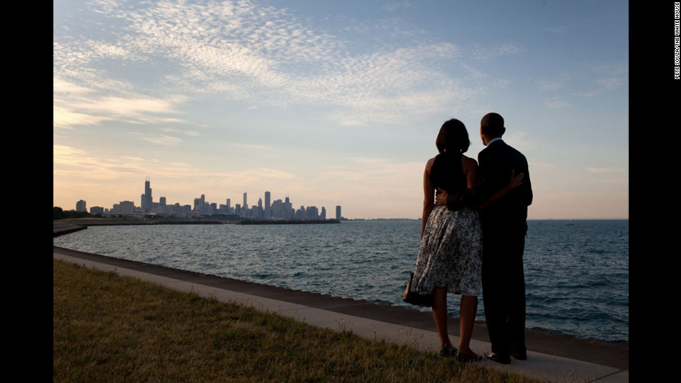 "The president and first lady look out at the city skyline and Lake Michigan after arriving at Burnham Park in Chicago on June 15, 2012. <a href=""http://lightbox.time.com/2012/10/08/pete-souza-portrait-of-a-presidency/#1"" target=""_blank"">See the entire gallery on Time LightBox.</a>"