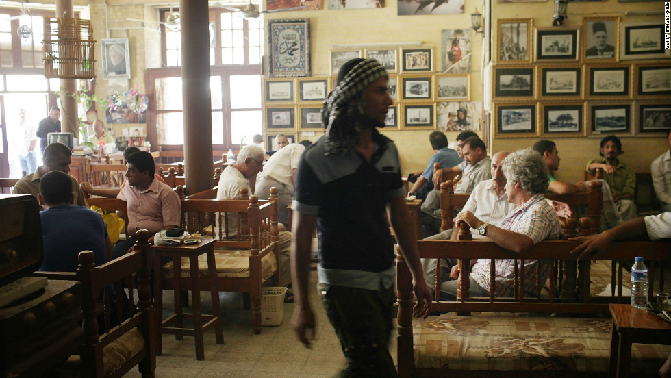 People enjoy an afternoon at the Al-Shah Bender Cafe, one of the oldest tea shops -- and a legendary gathering place for Iraqi artists and writers -- in Baghdad in 2011.