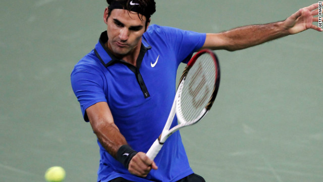 Roger Federer plays a backhand return during his second round victory over Yen-Hsun Lu at the Shanghai Masters.