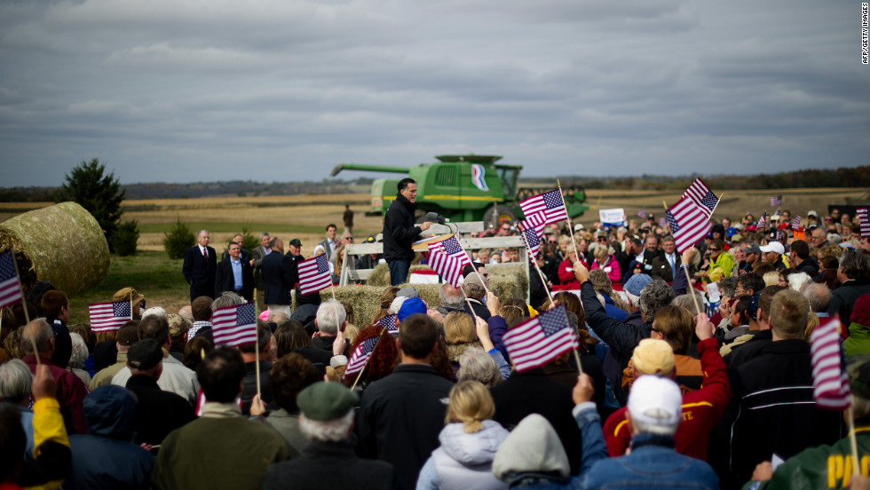 Supporters cheer as Romney delivers remarks on the James Koch Farm in Van Meter, Iowa, on Tuesday.