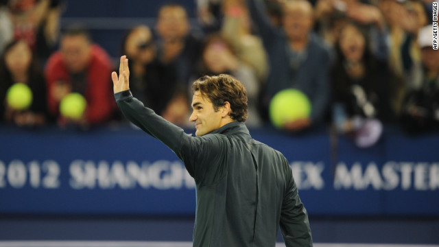 Roger Federer waves to the crowd in Shanghai after his victory over fellow Swiss Stanislas Wawrinka