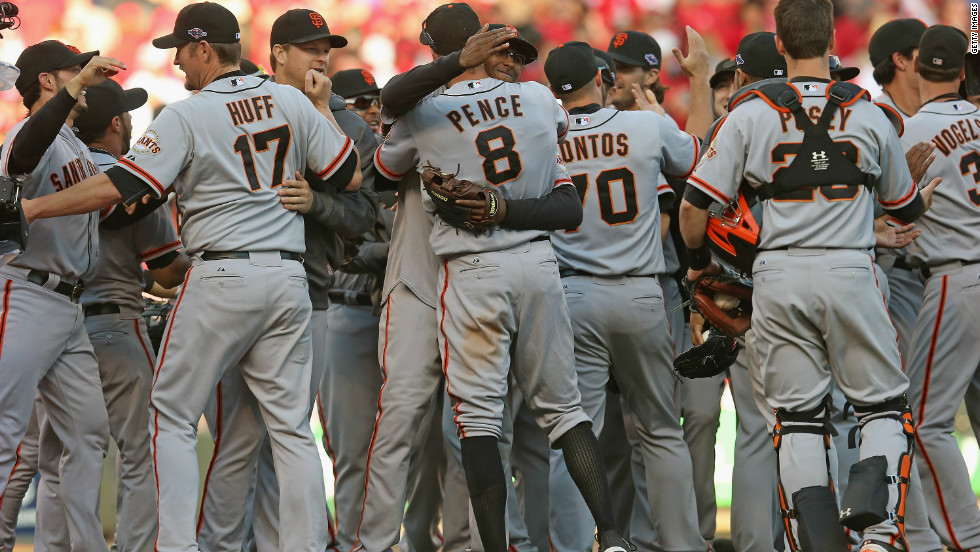 The San Francisco Giants celebrate their 6-4 win Thursday over the Cincinnati Reds. The Giants won the National League Division Series three games to two.