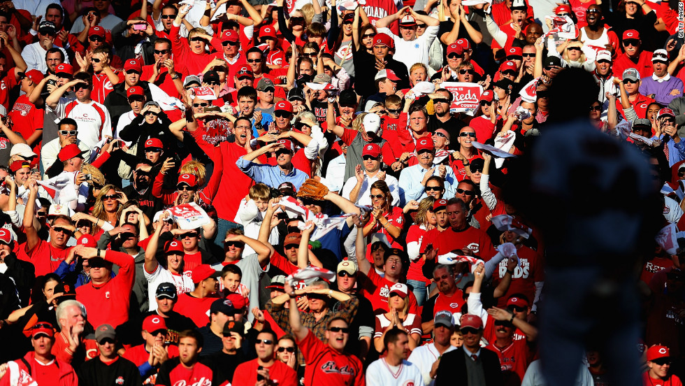 Cincinnati Reds fans cheer in the ninth inning as San Francisco's Sergio Romo waits to pitch. Cincinnati scored a run in the ninth but it wasn't enough as the Giants won the game and the series.