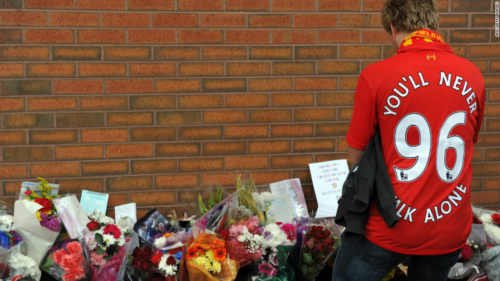 A Liverpool supporter pays his respects outside Anfield in September 2012, weeks before Britain's police watchdog said it would launch the biggest-ever independent inquiry into potential police wrongdoing after a damning report on the disaster.