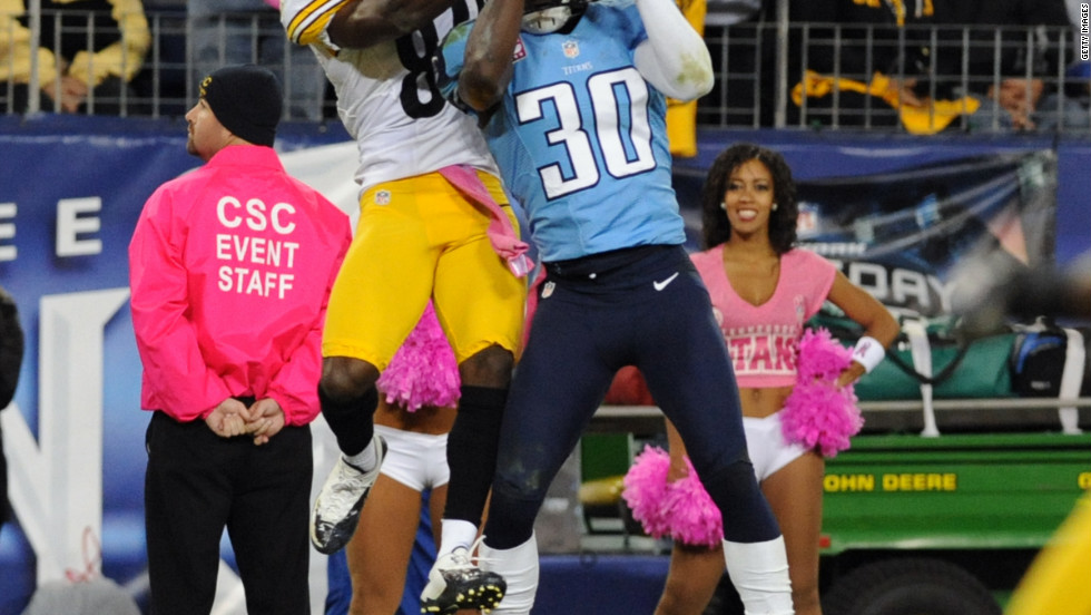 No. 30 cornerback Jason McCourty of the Tennessee Titans intercepts a pass late in the second quarter.