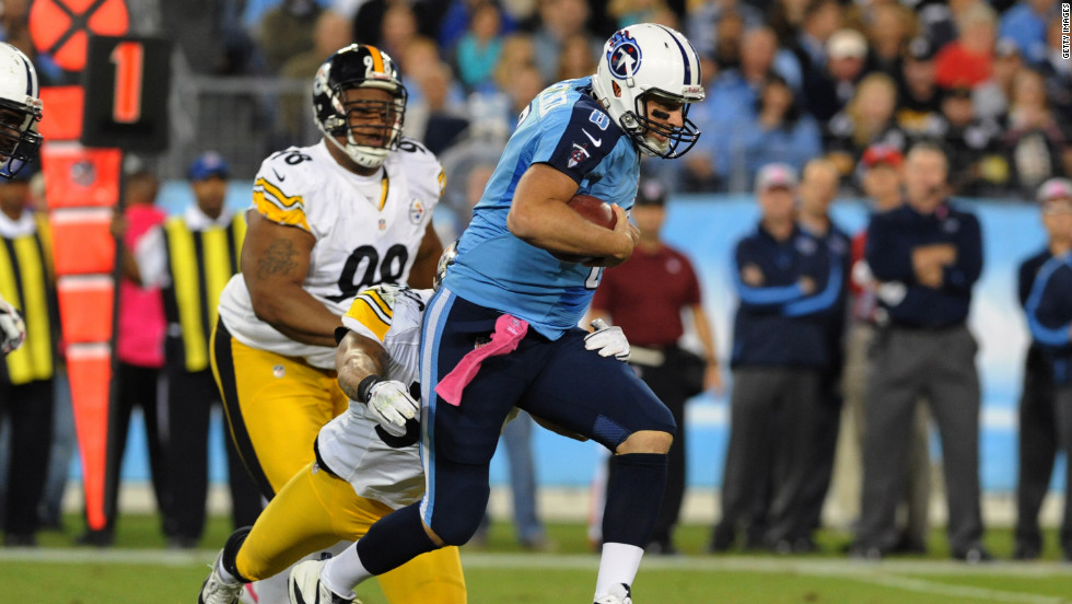 No. 8 quarterback Matt Hasselbeck of the Titans runs from the pocket against the Steelers.