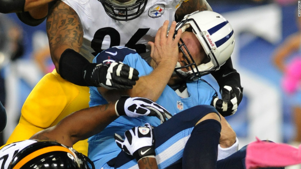 No. 96 defensive end Ziggy Hood and No. 92 linebacker James Harrison of the Steelers sack No.8 quarterback Matt Hasselbeck of the Titans on Thursday.
