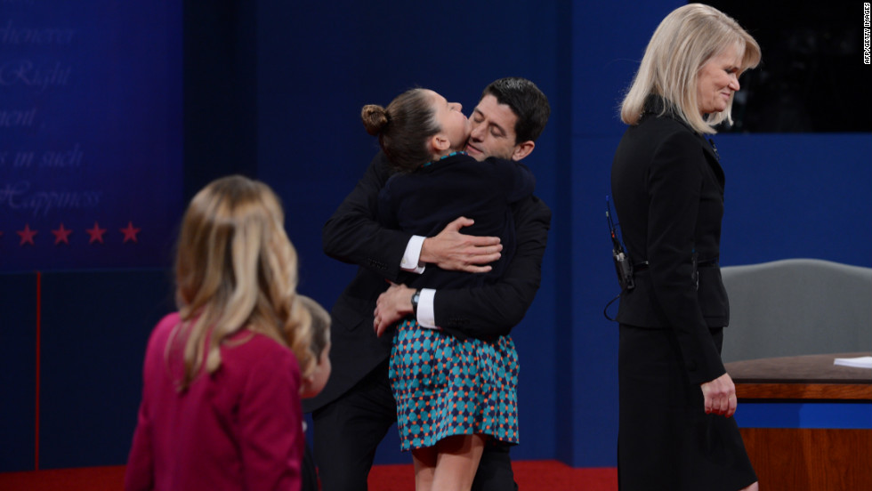 Vice presidential candidate Ryan greets family following his debate with Vice President Biden.