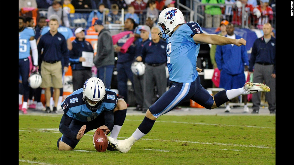 Brett Kern of the Tennessee Titans holds the ball during a field goal attempt by teammate kicker Rob Bironas on Thursday.