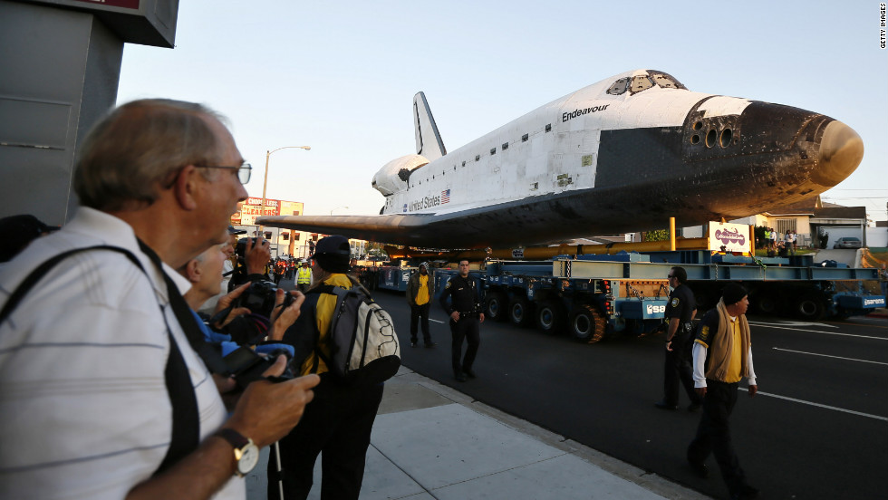 Endeavour is on its last mission: a 12-mile creep through city streets, past an eclectic mix of strip malls, mom-and-pop shops, tidy lawns and faded apartment buildings.