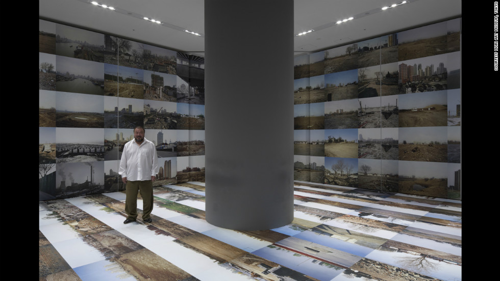 "Ai Weiwei poses in 2009 at the Mori Art Museum inTokyo with his work ""Provisional Landscape"" (2002-2008). It's now on display at the Hirshhorn Museum in Washington."