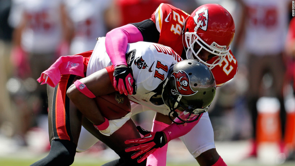Brandon Flowers of Kansas City tackles Tampa Bay receiver Tiquan Underwood.