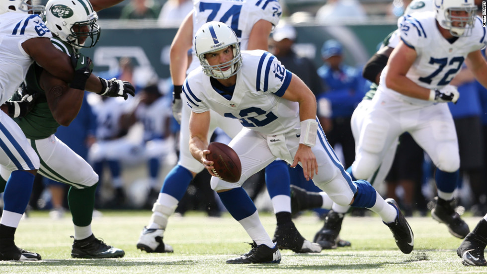 Quarterback Andrew Luck of the Indianapolis Colts runs with the ball against the New York Jets on Sunday at MetLife Stadium in East Rutherford, New Jersey.