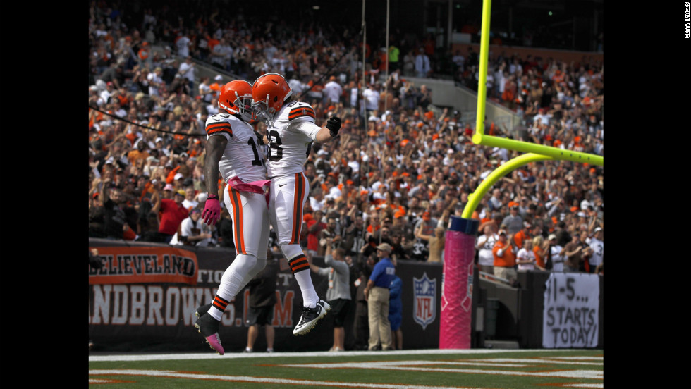 Cleveland's Josh Gordon, left, celebrates with a teammate after scoring a touchdown against Cincinnati.