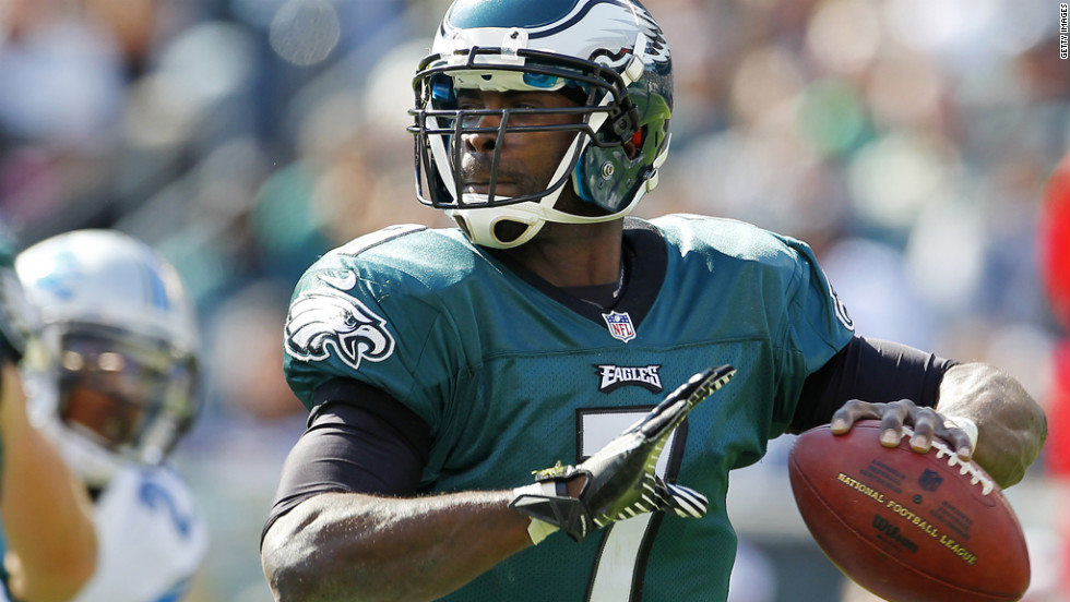 Eagles quarterback Michael Vick looks to pass against the Lions.