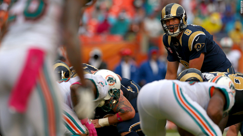 Rams quarterback Sam Bradford gets ready to take a snap Sunday against the Dolphins.