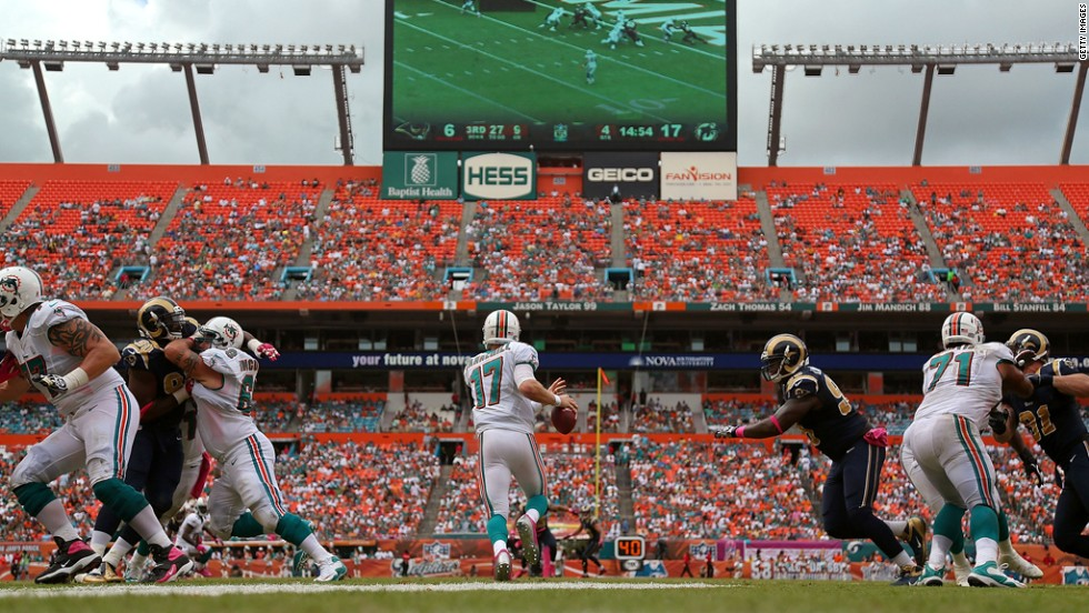 Dolphins quarterback Ryan Tannehill looks to pass downfield against the Rams on Sunday.
